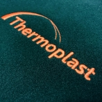Embroidered Thermoplast logo on fleece. The best quality logo on the chest. best quality computer embroidery.